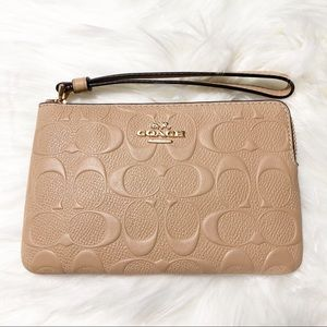 NWT Embossed Coach Wristlet